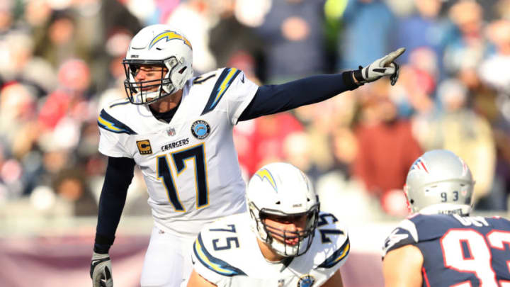 FOXBOROUGH, MASSACHUSETTS - JANUARY 13: Philip Rivers #17 of the Los Angeles Chargers reacts during the second quarter in the AFC Divisional Playoff Game against the New England Patriots at Gillette Stadium on January 13, 2019 in Foxborough, Massachusetts. (Photo by Elsa/Getty Images)