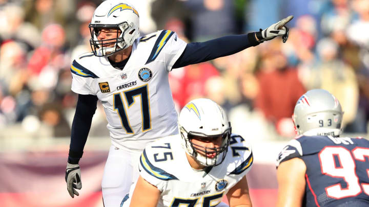 FOXBOROUGH, MASSACHUSETTS – JANUARY 13: Philip Rivers #17 of the Los Angeles Chargers reacts during the second quarter in the AFC Divisional Playoff Game against the New England Patriots at Gillette Stadium on January 13, 2019 in Foxborough, Massachusetts. (Photo by Elsa/Getty Images)