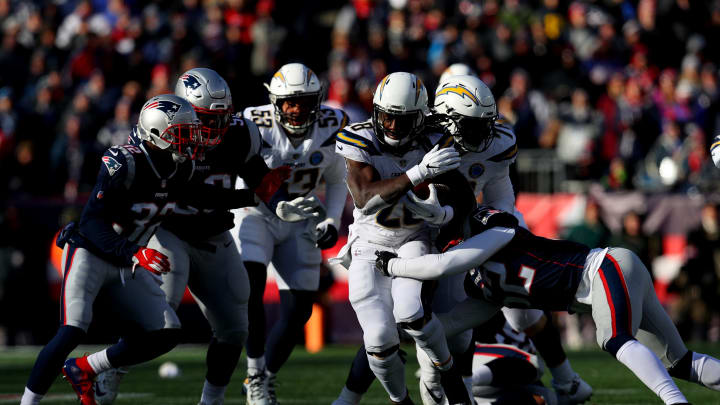 FOXBOROUGH, MASSACHUSETTS – JANUARY 13: Melvin Gordon #28 of the Los Angeles Chargers carries the ball during the first quarter in the AFC Divisional Playoff Game against the New England Patriots at Gillette Stadium on January 13, 2019 in Foxborough, Massachusetts. (Photo by Maddie Meyer/Getty Images)