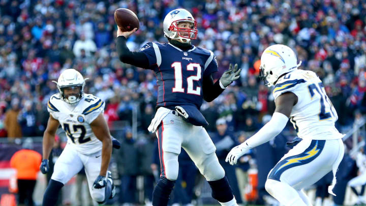 FOXBOROUGH, MASSACHUSETTS – JANUARY 13: Tom Brady #12 of the New England Patriots throws during the third quarter in the AFC Divisional Playoff Game against the Los Angeles Chargers at Gillette Stadium on January 13, 2019, in Foxborough, Massachusetts. (Photo by Adam Glanzman/Getty Images)