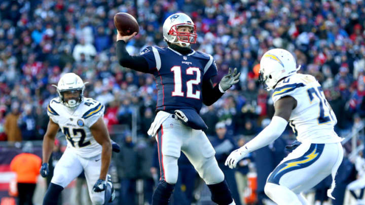 FOXBOROUGH, MASSACHUSETTS - JANUARY 13: Tom Brady #12 of the New England Patriots throws during the third quarter in the AFC Divisional Playoff Game against the Los Angeles Chargers at Gillette Stadium on January 13, 2019 in Foxborough, Massachusetts. (Photo by Adam Glanzman/Getty Images)