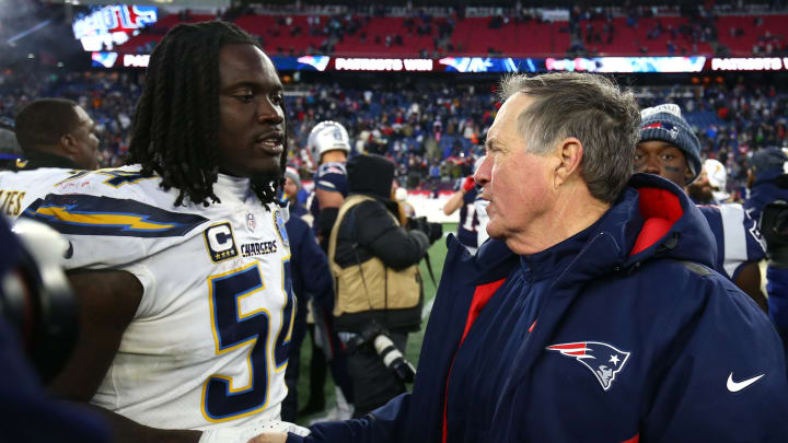 FOXBOROUGH, MASSACHUSETTS – JANUARY 13: Head coach Bill Belichick of the New England Patriots shakes hands with Melvin Ingram #54 of the Los Angeles Chargers after the AFC Divisional Playoff Game at Gillette Stadium on January 13, 2019, in Foxborough, Massachusetts. (Photo by Adam Glanzman/Getty Images)