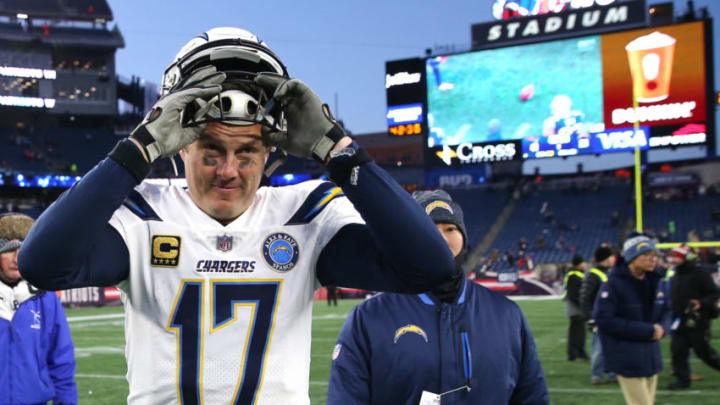 FOXBOROUGH, MASSACHUSETTS - JANUARY 13: Philip Rivers #17 of the Los Angeles Chargers reacts as he walks off the field after the AFC Divisional Playoff Game against the New England Patriots at Gillette Stadium on January 13, 2019 in Foxborough, Massachusetts. (Photo by Elsa/Getty Images)