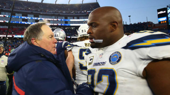 FOXBOROUGH, MASSACHUSETTS - JANUARY 13: Head coach Bill Belichick of the New England Patriots shakes hands with Brandon Mebane #92 of the Los Angeles Chargers following the AFC Divisional Playoff Game at Gillette Stadium on January 13, 2019 in Foxborough, Massachusetts. (Photo by Adam Glanzman/Getty Images)