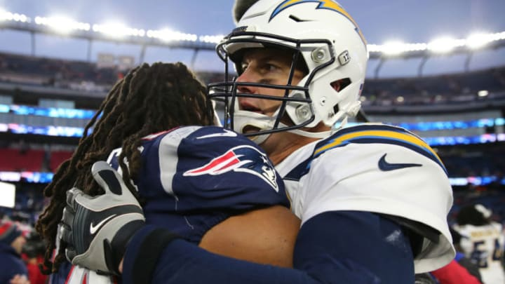 FOXBOROUGH, MASSACHUSETTS - JANUARY 13: Philip Rivers #17 of the Los Angeles Chargers hugs Dont'a Hightower #54 of the New England Patriots after the AFC Divisional Playoff Game against the New England Patriots at Gillette Stadium on January 13, 2019 in Foxborough, Massachusetts. (Photo by Elsa/Getty Images)
