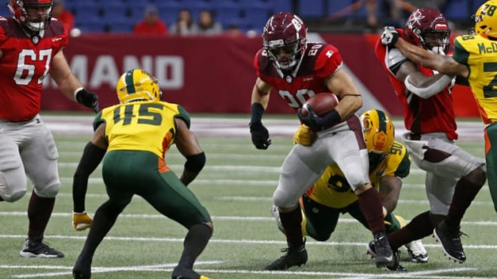 SAN ANTONIO, TX - MARCH 31: Kenneth Farrow II #20 of the San Antonio Commanders tries to shake the tackle of Will Sutton III #90 of the Arizona Hotshots during an Alliance of American Football game at the Alamodome on March 31, 2019 in San Antonio, Texas. (Photo by Edward A. Ornelas/Getty Images)