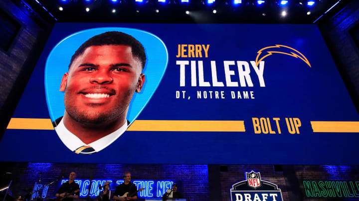 NASHVILLE, TENNESSEE – APRIL 25: A video board displays an image of Jerry Tillery of Notre Dame after he was chosen #28 overall by the Los Angeles Chargers during the first round of the 2019 NFL Draft on April 25, 2019 in Nashville, Tennessee. (Photo by Andy Lyons/Getty Images)