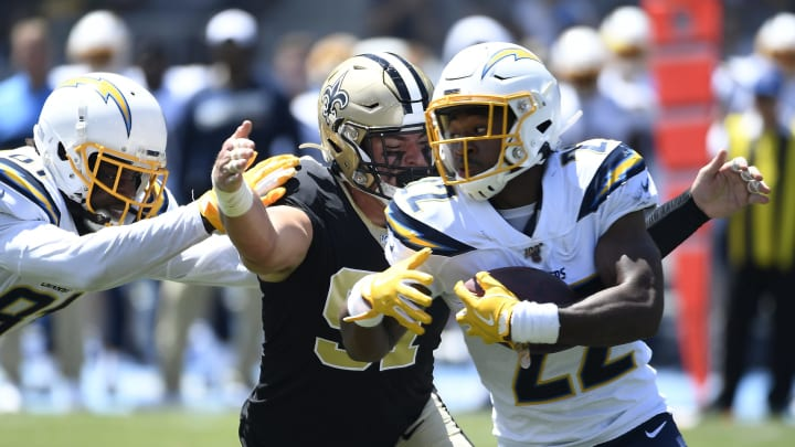 CARSON, CA – AUGUST 18: Trey Hendrickson #91 of the New Orleans Saints unable to tackle running back Justin Jackson #22 of the Los Angeles Chargers during the first half of their pre-seaon football game at Dignity Health Sports Park on August 18, 2019 in Carson, California. (Photo by Kevork Djansezian/Getty Images)