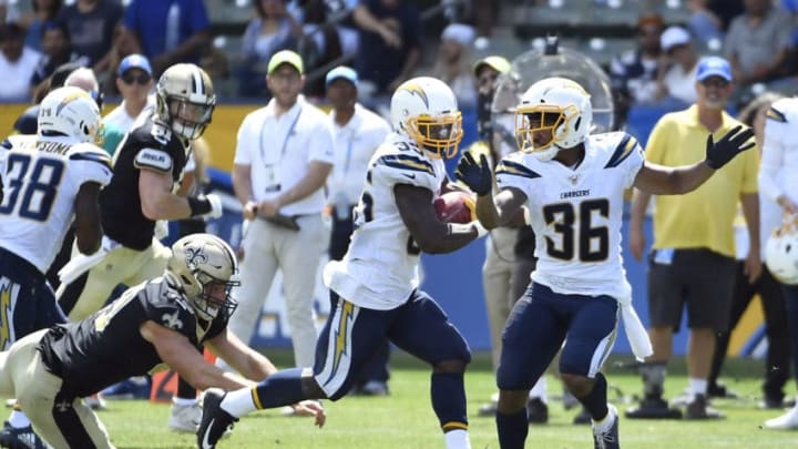 CARSON, CA - AUGUST 18: Troymaine Pope #35 of the Los Angeles Chargers eludes a tackles as runs back a punt for a touchdown during the first half of their pre seaon football game against New Orleans Saints at Dignity Health Sports Park on August 18, 2019 in Carson, California. (Photo by Kevork Djansezian/Getty Images)