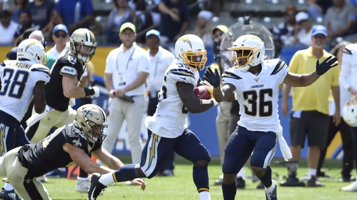 CARSON, CA – AUGUST 18: Troymaine Pope #35 of the Los Angeles Chargers eludes tackles as runs back a punt for a touchdown during the first half of their preseason football game against New Orleans Saints at Dignity Health Sports Park on August 18, 2019, in Carson, California. (Photo by Kevork Djansezian/Getty Images)