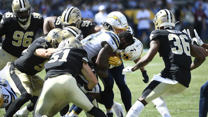 CARSON, CA – AUGUST 18: Detrez Newsome #38 of the Los Angeles Chargers has his helmet knocked out by New Orleans Saints defenders during the second half of their pre seaon football game at Dignity Health Sports Park on August 18, 2019 in Carson, California. (Photo by Kevork Djansezian/Getty Images)