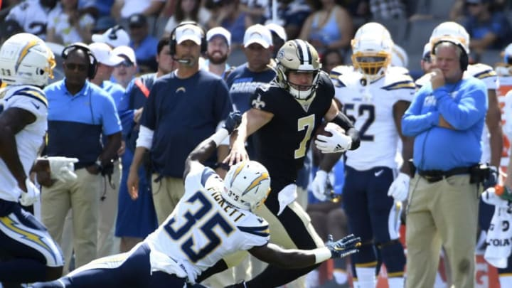 CARSON, CA - AUGUST 18: Quarterback Taysom Hill #7 of the New Orleans Saints rushes for a gain against Adarius Pickett #35 of the Los Angeles Chargers during the second half of their pre season football game at Dignity Health Sports Park on August 18, 2019 in Carson, California. (Photo by Kevork Djansezian/Getty Images)