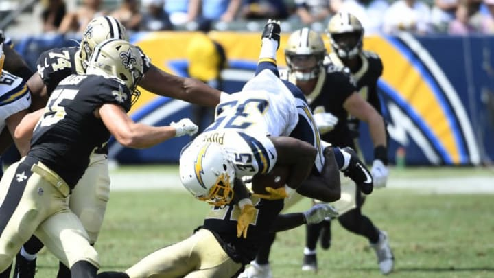 CARSON, CA - AUGUST 18: Troymaine Pope #35 of the Los Angeles Chargers is stopped by Chauncey Gardner-Johnson #22 of the New Orleans Saints during the second half of their pre season football game at Dignity Health Sports Park on August 18, 2019 in Carson, California. (Photo by Kevork Djansezian/Getty Images)