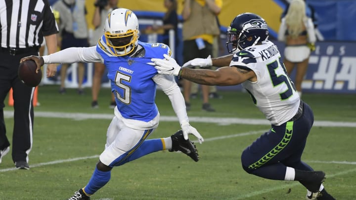 CARSON, CA – AUGUST 24: Tyrod Taylor #5 of the Los Angeles Chargers runs out of the pocket to get away from Mychal Kendricks #56 of the Seattle Seahawks in the first quarter during a preseason NFL football game at Dignity Health Sports Park on August 24, 2019, in Carson, California. (Photo by John McCoy/Getty Images)