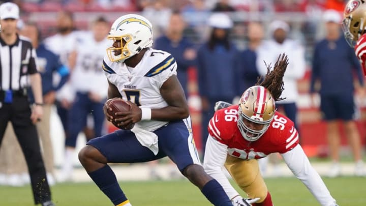 SANTA CLARA, CA - AUGUST 29: Cardale Jones #7 of the Los Angeles Chargers scrambles away from the pressure of Sheldon Day #96 of the San Francisco 49ers during the first quarter of an NFL football game at Levi's Stadium on August 29, 2019 in Santa Clara, California. (Photo by Thearon W. Henderson/Getty Images)