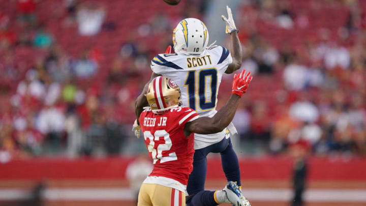 SANTA CLARA, CA - AUGUST 29: Artavis Scott #10 of the Los Angeles Chargers catches a pass over D.J. Reed #32 of the San Francisco 49ers during the first quarter of an NFL football game at Levi's Stadium on August 29, 2019 in Santa Clara, California. (Photo by Thearon W. Henderson/Getty Images)