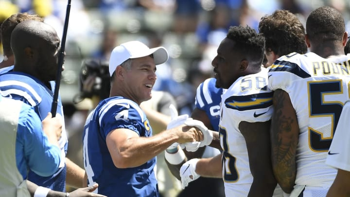 CARSON, CA – SEPTEMBER 08: Kicker Adam Vinatieri #4 of the Indianapolis Colts at shakes hands with outside linebacker Thomas Davis #58 of the Los Angeles Chargers after the coin toss to kick off their season opener at Dignity Health Sports Park on September 8, 2019, in Carson, California. (Photo by Kevork Djansezian/Getty Images)