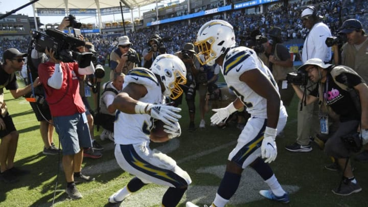 CARSON, CA - SEPTEMBER 08: Running back Austin Ekeler #30 of the Los Angeles Chargers dances with Justin Jackson #22 at the end of the game after scoring the winning touchdown in overtime against Indianapolis Colts at Dignity Health Sports Park on September 8, 2019 in Carson, California. (Photo by Kevork Djansezian/Getty Images)