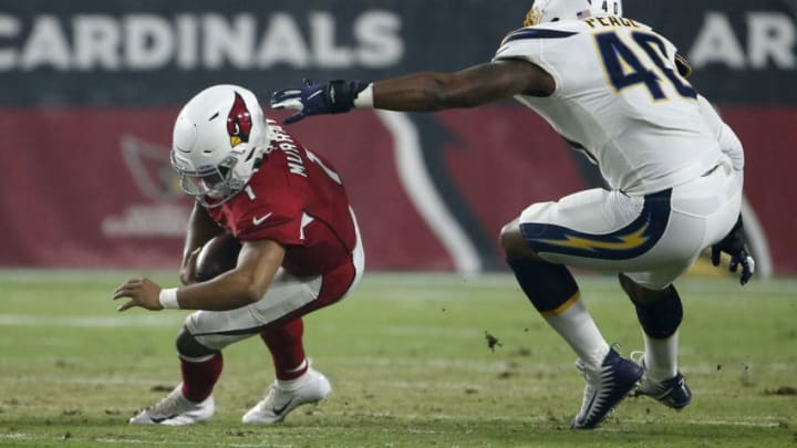 GLENDALE, ARIZONA - AUGUST 08: Quarterback Kyler Murray #1 of the Arizona Cardinals tries to avoid a sack by Chris Peace #40 of the Los Angeles Chargers during the first half of the NFL pre-season game at State Farm Stadium on August 08, 2019 in Glendale, Arizona. (Photo by Ralph Freso/Getty Images)
