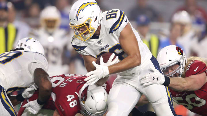 GLENDALE, ARIZONA – AUGUST 08: Hunter Henry #86 of the Los Angeles Chargers is tackled by the Arizona Cardinals during a preseason game at State Farm Stadium on August 08, 2019 in Glendale, Arizona. (Photo by Christian Petersen/Getty Images)