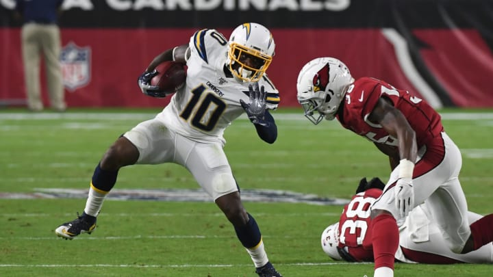 GLENDALE, ARIZONA – AUGUST 08: Artavis Scott #10 of the Los Angeles Chargers runs with the ball while avoiding a tackle by Deionte Thompson #35 of the Arizona Cardinals during the first half of an NFL preseason game at State Farm Stadium on August 08, 2019 in Glendale, Arizona. (Photo by Norm Hall/Getty Images)