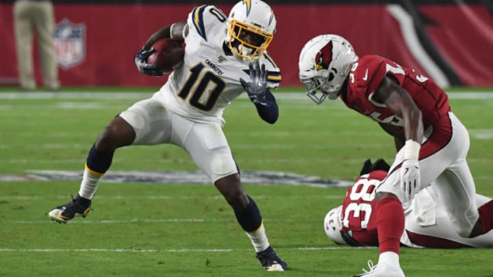 GLENDALE, ARIZONA - AUGUST 08: Artavis Scott #10 of the Los Angeles Chargers runs with the ball while avoiding a tackle by Deionte Thompson #35 of the Arizona Cardinals during the first half of an NFL preseason game at State Farm Stadium on August 08, 2019 in Glendale, Arizona. (Photo by Norm Hall/Getty Images)