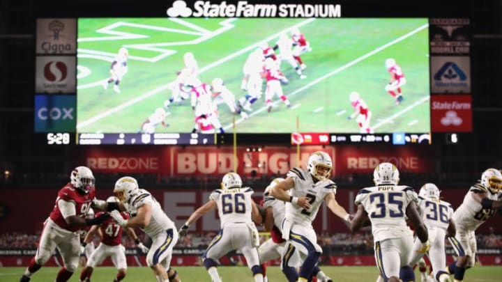 GLENDALE, ARIZONA - AUGUST 08: Quarterback Easton Stick #2 of the Los Angeles Chargers hands off the football to running back Troymaine Pope #35 during the NFL preseason game against the Arizona Cardinals at State Farm Stadium on August 08, 2019 in Glendale, Arizona. The Cardinals defeated the Chargers 17-13. (Photo by Christian Petersen/Getty Images)