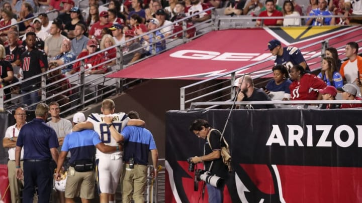GLENDALE, ARIZONA - AUGUST 08: Tight end Andrew Vollert #87 of the Los Angeles Chargers is helped off the field after an injury during the NFL preseason game against the Arizona Cardinals at State Farm Stadium on August 08, 2019 in Glendale, Arizona. The Cardinals defeated the Chargers 17-13. (Photo by Christian Petersen/Getty Images)