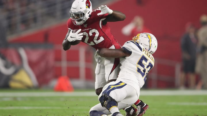 GLENDALE, ARIZONA – AUGUST 08: Running back T.J. Logan #22 of the Arizona Cardinals is tackled by middle linebacker Denzel Perryman #52 of the Los Angeles Chargers during the NFL preseason game at State Farm Stadium on August 08, 2019 in Glendale, Arizona. The Cardinals defeated the Chargers 17-13. (Photo by Christian Petersen/Getty Images)