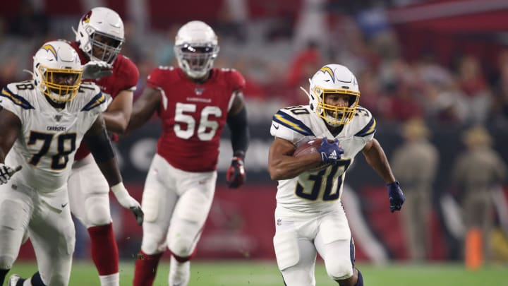 GLENDALE, ARIZONA – AUGUST 08: Running back Austin Ekeler #30 of the Los Angeles Chargers rushes the football against the Arizona Cardinals during the NFL preseason game at State Farm Stadium on August 08, 2019 in Glendale, Arizona. The Cardinals defeated the Chargers 17-13. (Photo by Christian Petersen/Getty Images)