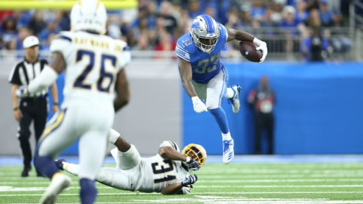 DETROIT, MI - SEPTEMBER 15: Kerryon Johnson #33 of the Detroit Lions runs for a first down during the fourth quarter of the game against Adrian Phillips #31 of the Los Angeles Chargers at Ford Field on September 15, 2019 in Detroit, Michigan. (Photo by Rey Del Rio/Getty Images)