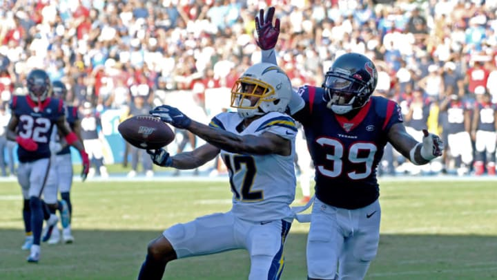 CARSON, CA - SEPTEMBER 22: Wide receiver Travis Benjamin #12 of the Los Angeles Chargers can't hang on to the ball in the end zone as free safety Tashaun Gipson #39 of the Houston Texans defends in the final seconds of the game at Dignity Health Sports Park on September 22, 2019 in Carson, California. (Photo by Jayne Kamin-Oncea/Getty Images)