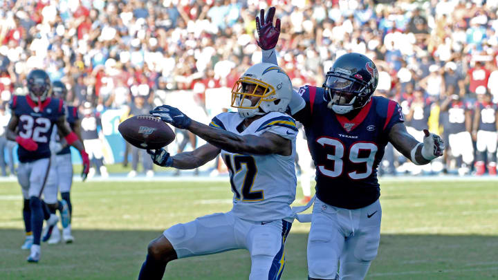 CARSON, CA – SEPTEMBER 22: Wide receiver Travis Benjamin #12 of the Los Angeles Chargers can't hang on to the ball in the end zone as free safety Tashaun Gipson #39 of the Houston Texans defends in the final seconds of the game at Dignity Health Sports Park on September 22, 2019 in Carson, California. (Photo by Jayne Kamin-Oncea/Getty Images)