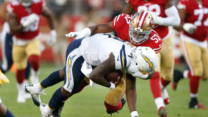 SANTA CLARA, CALIFORNIA – AUGUST 29: Quarterback Cardale Jones #7 of the Los Angeles Chargers is tackled by Dre Greenlaw #57 of the San Francisco 49ers during the preseason game at Levi's Stadium on August 29, 2019 in Santa Clara, California. (Photo by Lachlan Cunningham/Getty Images)