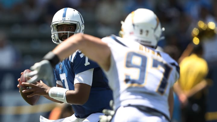 CARSON, CALIFORNIA – SEPTEMBER 08: Jacoby Brissett #7 of the Indianapolis Colts looks to pass under pressure from Joey Bosa #97 of the Los Angeles Chargers during the first half of a gameat Dignity Health Sports Park on September 08, 2019 in Carson, California. (Photo by Sean M. Haffey/Getty Images)
