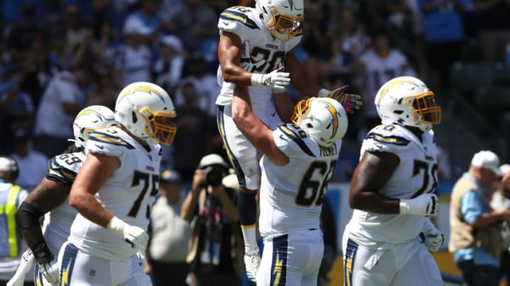 CARSON, CALIFORNIA - SEPTEMBER 08: Austin Ekeler #30 is congratulated by Dan Feeney #66 of the Los Angeles Chargers after scoring a touchdown during the first half of a game against the Indianapolis Colts at Dignity Health Sports Park on September 08, 2019 in Carson, California. (Photo by Sean M. Haffey/Getty Images)