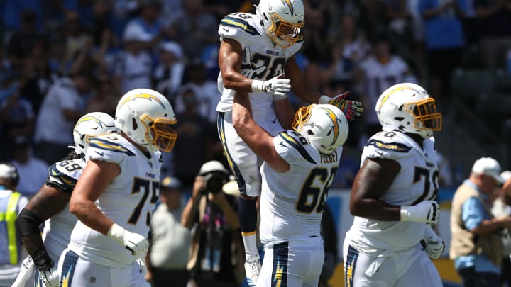 CARSON, CALIFORNIA – SEPTEMBER 08: Austin Ekeler #30 is congratulated by Dan Feeney #66 of the Los Angeles Chargers after scoring a touchdown during the first half of a game against the Indianapolis Colts at Dignity Health Sports Park on September 08, 2019 in Carson, California. (Photo by Sean M. Haffey/Getty Images)