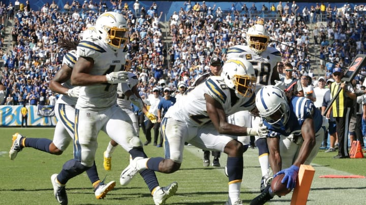 CARSON, CALIFORNIA – SEPTEMBER 08: T.Y. Hilton #13 of the Indianapolis Colts dives into the end zone for a touchdown while pursued by Brandon Facyson #28 of the Los Angeles Chargers in the fourth quarter at Dignity Health Sports Park on September 08, 2019 in Carson, California. The Chargers defeated the Colts 30-24 in overtime. (Photo by Jeff Gross/Getty Images)