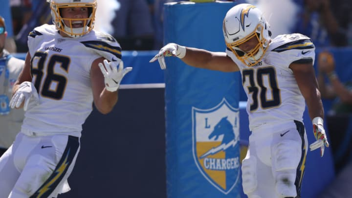 CARSON, CALIFORNIA - SEPTEMBER 08: Hunter Henry #86 congratulates Austin Ekeler #30 of the Los Angeles Chargers after his touchdown during the first half of a game against the Indianapolis Coltsat Dignity Health Sports Park on September 08, 2019 in Carson, California. (Photo by Sean M. Haffey/Getty Images)