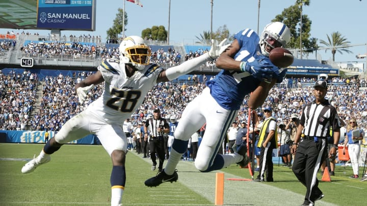 CARSON, CALIFORNIA – SEPTEMBER 08: Devin Funchess #17 of the Indianapolis Colts can't come down with the catch while pursued by Brandon Facyson #28 of the Los Angeles Chargers in the fourth quarter at Dignity Health Sports Park on September 08, 2019 in Carson, California. The Chargers defeated the Colts 30-24 in overtime. (Photo by Jeff Gross/Getty Images)