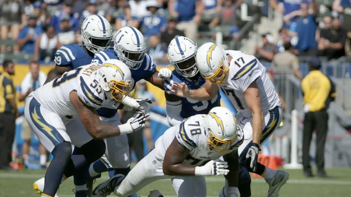 CARSON, CALIFORNIA – SEPTEMBER 08: Trent Scott #78 of the Los Angeles Chargers recovers a ball fumbled by quarterback Philip Rivers #17 in the third quarter against the Indianapolis Colts at Dignity Health Sports Park on September 08, 2019 in Carson, California. The Chargers defeated the Colts 30-24 in overtime. (Photo by Jeff Gross/Getty Images)
