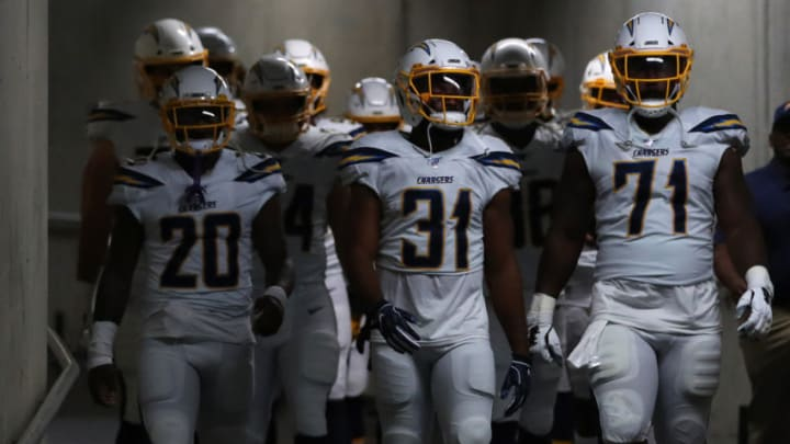 DETROIT, MICHIGAN - SEPTEMBER 15: Adrian Phillips #31, Damion Square #71 and Desmond King #20 of the Los Angeles Chargers walk down the tunnel to the field prior to playing the Detroit Lions at Ford Field on September 15, 2019 in Detroit, Michigan. (Photo by Gregory Shamus/Getty Images)
