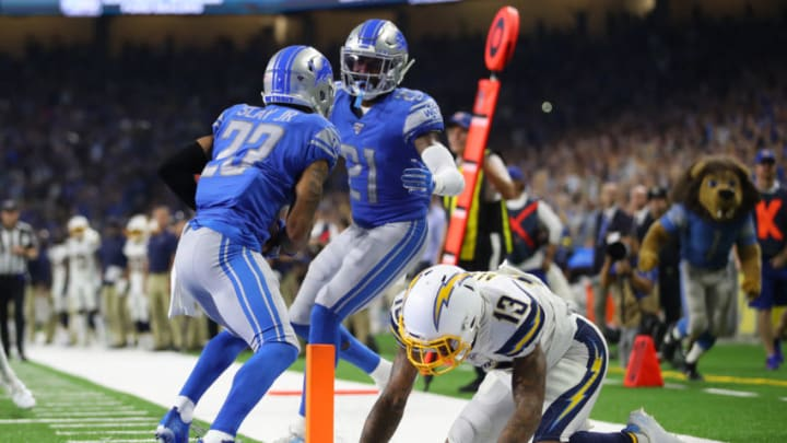 DETROIT, MICHIGAN - SEPTEMBER 15: Darius Slay #23 of the Detroit Lions celebrates his fourth quarter interception with Tracy Walker #21 next to Keenan Allen #13 of the Los Angeles Chargers at Ford Field on September 15, 2019 in Detroit, Michigan. (Photo by Gregory Shamus/Getty Images)