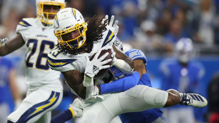 DETROIT, MICHIGAN – SEPTEMBER 15: Rayshawn Jenkins #23 of the Los Angeles Chargers makes a third quarter interception in front of Marvin Jones #11 of the Detroit Lions at Ford Field on September 15, 2019 in Detroit, Michigan. Detroit won the game 13-10. (Photo by Gregory Shamus/Getty Images)