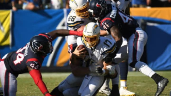 CARSON, CALIFORNIA – SEPTEMBER 22: Quarterback Philip Rivers #17 of the Los Angeles Chargers is tackled by defensive end J.J. Watt #99 of the Houston Texans at Dignity Health Sports Park on September 22, 2019 in Carson, California. (Photo by Meg Oliphant/Getty Images)