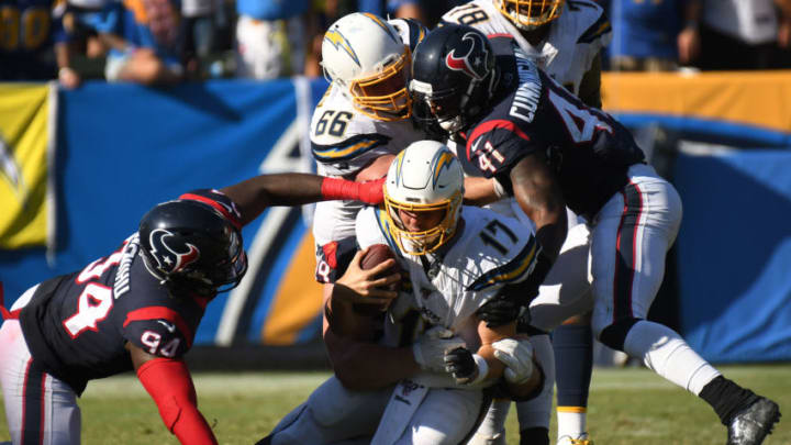 CARSON, CALIFORNIA - SEPTEMBER 22: Quarterback Philip Rivers #17 of the Los Angeles Chargers is tackled by defensive end J.J. Watt #99 of the Houston Texans at Dignity Health Sports Park on September 22, 2019 in Carson, California. (Photo by Meg Oliphant/Getty Images)
