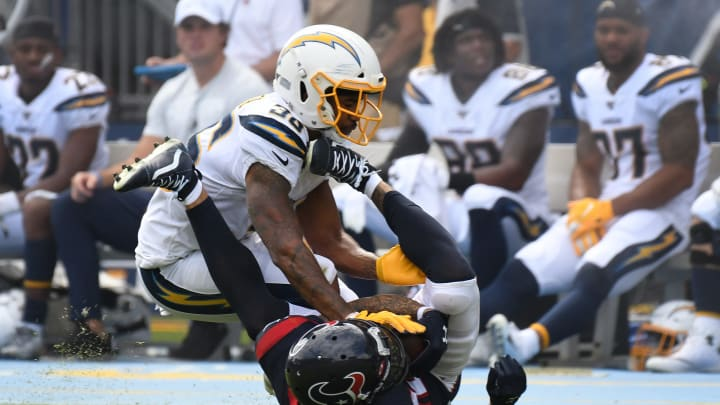 CARSON, CALIFORNIA – SEPTEMBER 22: Wide receiver Kenny Stills #12 of the Houston Texans and defensive back Roderic Teamer #36 of the Los Angeles Chargers fall after a pass play at Dignity Health Sports Park on September 22, 2019 in Carson, California. (Photo by Meg Oliphant/Getty Images)