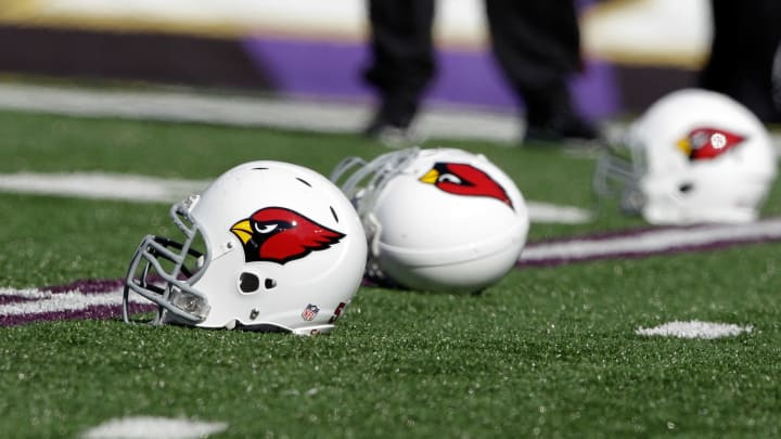 BALTIMORE, MD – OCTOBER 30: Helmets belonging to the Arizona Cardinals sit on the turf before the start of the Cardinals game against the Baltimore Ravens at M&T Bank Stadium on October 30, 2011 in Baltimore, Maryland. (Photo by Rob Carr/Getty Images)