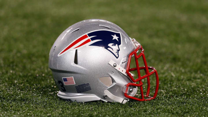BALTIMORE, MD - SEPTEMBER 23: A New England Patriots helmet sits on the turf before the start of the Patriots game against the Baltimore Ravens at M