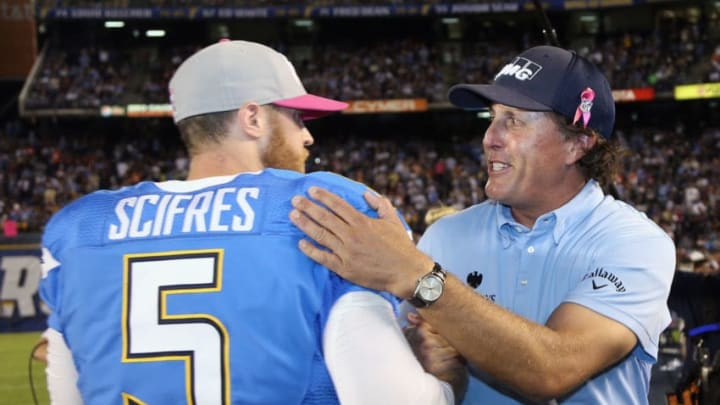SAN DIEGO, CA - OCTOBER 15: Mike Scifres #5 of the San Diego Chargers and Hall-of-Fame golfer Phil Mickelson greet one another on the field at halftime of the NFL game between the Denver Broncos and the San Diego Chargers at Qualcomm Stadium on October 15, 2012 in San Diego, California. (Photo by Jeff Gross/Getty Images)
